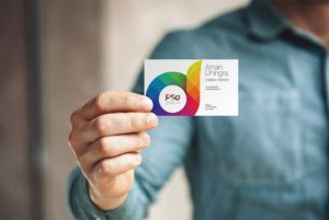 Creative Man Holding Business Card Mockup PSD
